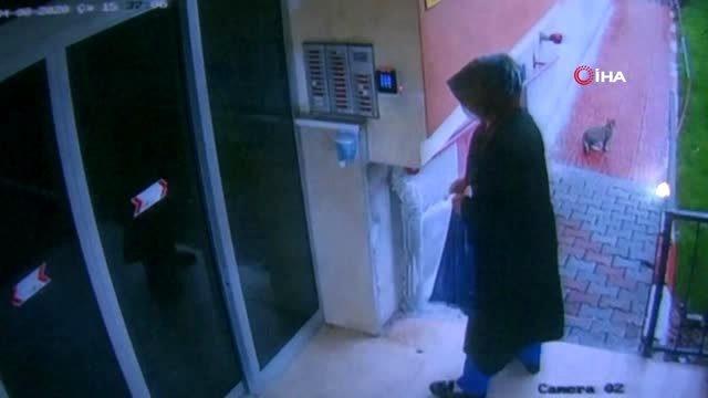 Elindeki sıvı maddeyi asansör ve kapılara süren esrarengiz kadın yakalandı