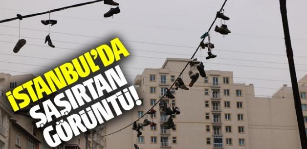 Esenyurt'ta elektrik kablolarına asılı onlarca ayakkabı şaşırttı