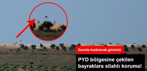 Sınırda Kızdıracak Görüntü! PYD Bölgesine Çekilen Bayraklara Silahlı Koruma