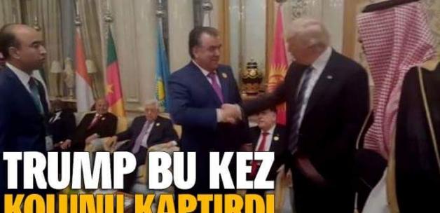 Trump, Tacik mevkidaşına kolunu kaptırdı