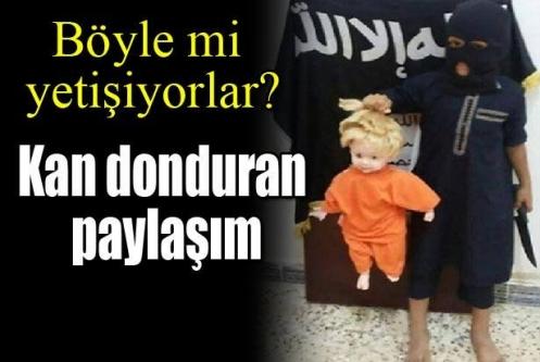 Küçük IŞİD militanı oyuncak bebek kesti