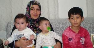 Üç çocuğuyla yeni yasanın çıkmasını...