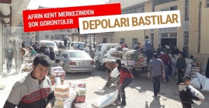Afrin'de halk YPG'nin depolarını basıp yağmaladı