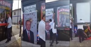 Fransalı Türkler gazete bayilerine asılan 'Erdoğan diktatör' afişlerini indirtti