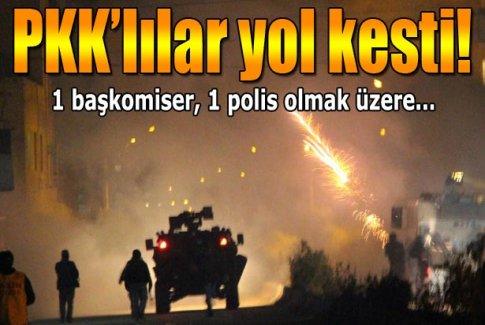 Yol kesen PKK'lılar polise ses bombası attı: 2 polis yaralı
